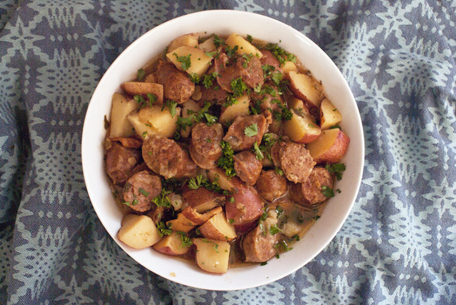 Cooked dublin coddle recipe with thick potatoes and chunks of sausage in a bowl