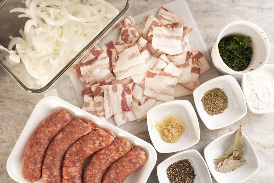 Ingredients for a dublin coddle including sausage, bacon, onions, spices