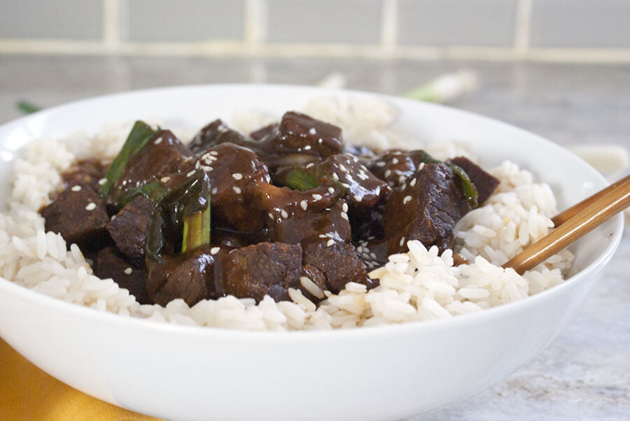 White bowl of rice with Crock pot mongolian beef on top