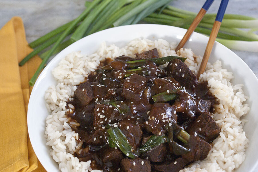 Mongolian beef made in the slow cooker on a bed of rice.