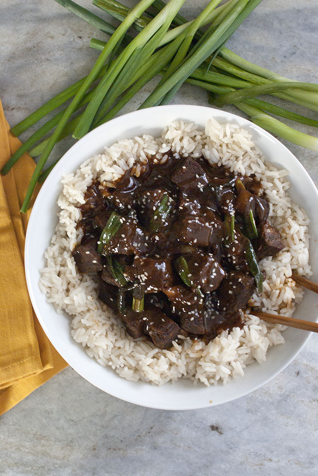 Slow cooker mongolian beef on a bed of white rice