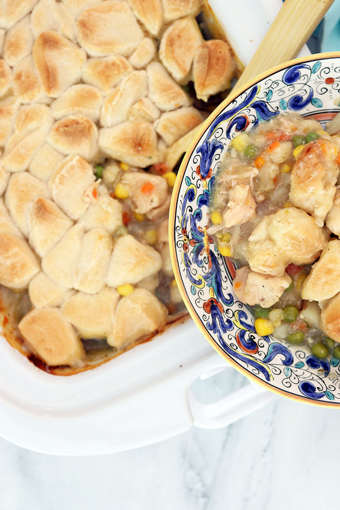 serving chicken pot pie with chicken, potatoes and carrots